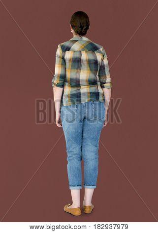 Woman casual standing in rear view studio portrait