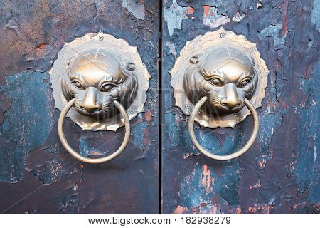 Chinese door knockers on a cracked door Chengdu Sichuan Province China