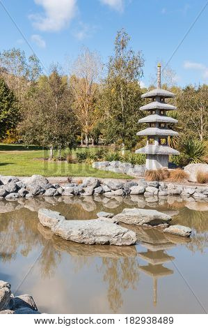 Japanese garden with pond and pagoda in autumn