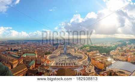 Rome Italy with Vatican city. Famous Saint Peter's Square in Vatican and aerial view of the city with building and panorama ancient cityscape in the morning cloud and light.