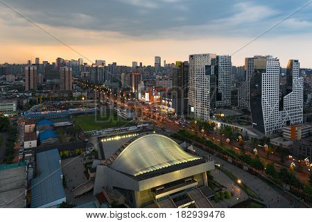 Chengdu Gymnasium And Raffles City Building At Dusk