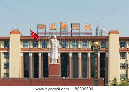 Chengdu Sichuan Province China - Apr 13 2017: Mao statue and chinese flag on a sunny day in front of the Sichuan Science and Technology museum Tianfu Square.