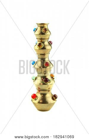Brass vase with decoration on a white background