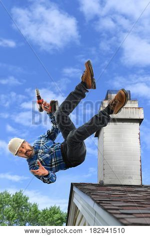 Senior Hispanic worker falling from roof while holding cordless drill