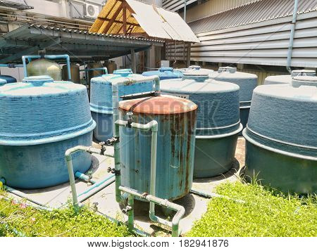 Cluster of Water supply tanks in industrial factory.