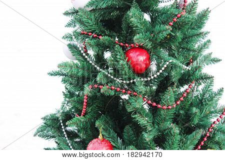Christmas tree with red balls and garlands