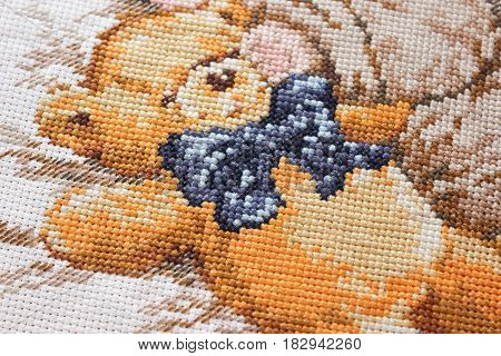 Floss embroidery cute bear with a blue bow