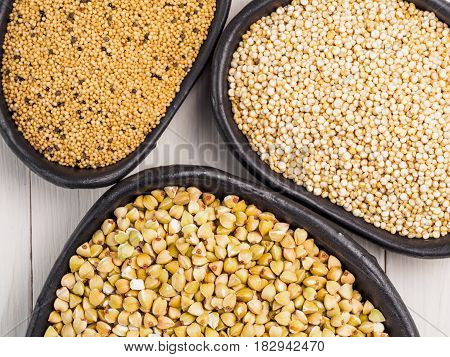 Green buckwheat, amaranth seeds and quinoa. Superfoods concept. Top view or flat lay.
