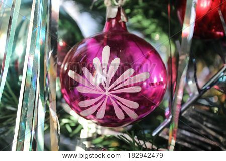 Pink ball with a pattern on a Christmas tree