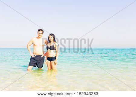 tourists standing in the water, persian gluf, jumeirah beach in dubai.