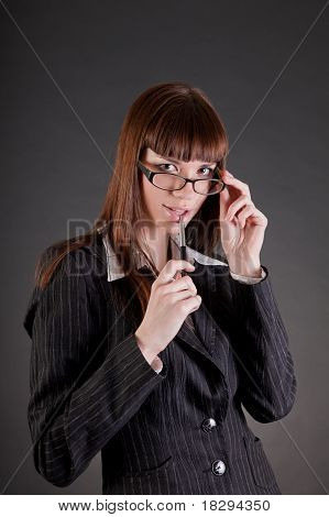Thoughtful Business Woman Wearing Glasses