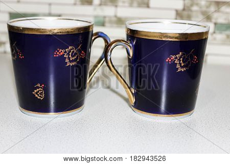 Blue mugs for tea with the image of berries