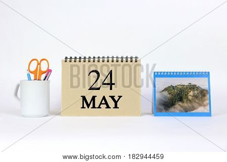 Deadline 24 May Calendar With White Background and Office.