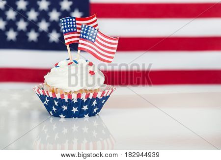 Patriotic 4th of July cupcake with American flags