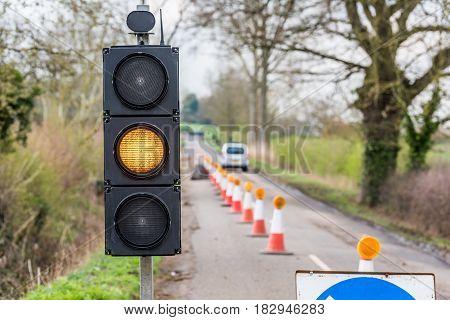 UK Motorway Roadworks Yellow Traffic Lights Cones.