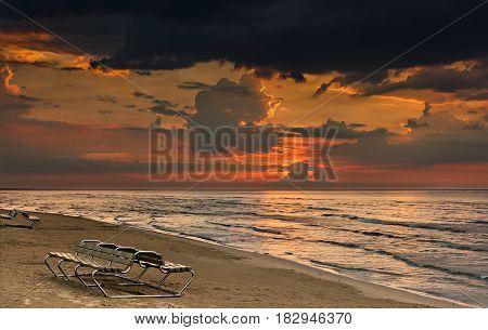 Colorful sunrise at sandy beach of famous resort of Jurmala, Latvia