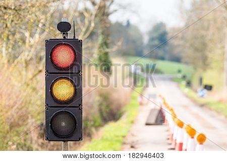 UK Motorway Roadworks Red Yellow Traffic Lights Cones.