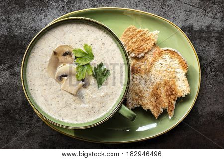 Creamy mushroom soup.  Top view on slate, with toast.