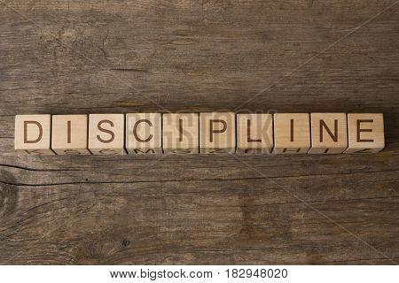 word discipline written on cubes on wooden background