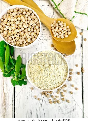 Flour Chickpeas In White Bowl With Peas On Board Top