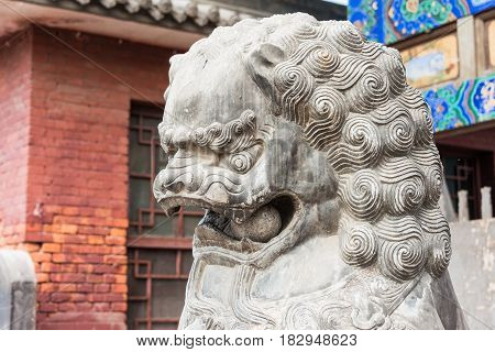 Shanxi, China - Sept 03 2015: Lion Statue At Shuanglin Temple(unesco World Heritage Site). A Famous