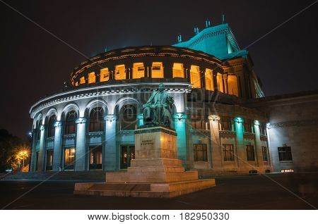 Yerevan Armenia - October 24 2016: National Academic Theatre of Opera and Ballet named after Alexander Spendiaryan of Armenia illuminated at night. Composer Spendiaryan statue.