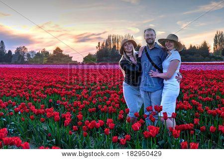 Happy family on tulip fields at sunset. Skagit Valley Tulip Festival. Seattle. Mount Vernon. WA. United States.