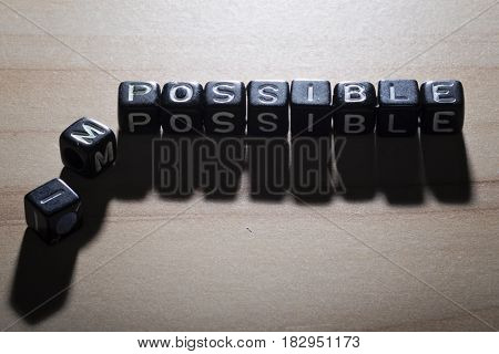 POSSIBLE and IMPOSSIBLE, by black alphabet beads
