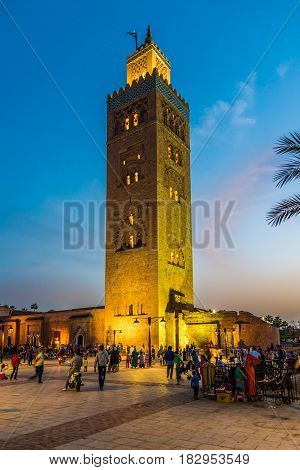 MARRAKESH, MOROCCO - APRIL 1,2017 - Evening near Minaret of the Koutoubia Mosque in Marrakesh. Marrakesh is the fourth largest city in the Morocco.