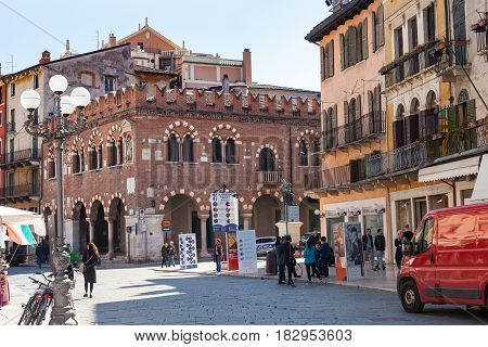 People And Palaces On Piazza Delle Erbe In Verona