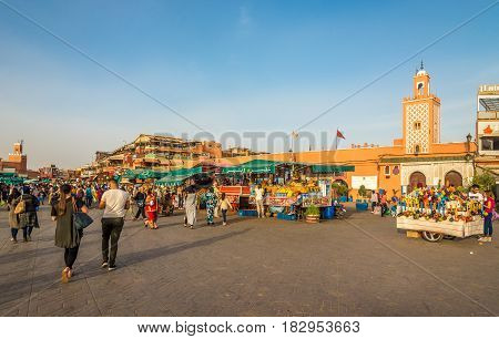 MARRAKESH, MOROCCO - MARCH 31,2017 - At the Jemaa el-Fnaa sqaure - Medina of Marrakesh. The Jemaa el-Fnaa is one of the best-known squares in Africa.
