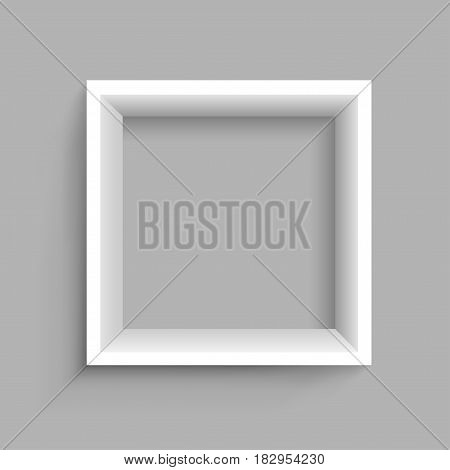 Modern square plastic wooden or paper white shelf with shadow on gray background. Frame furniture design