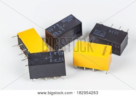 Electric relay 8 legs isolated on white background.