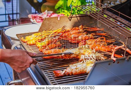 Hot BBQ Grilled river prawns on the picnic stove
