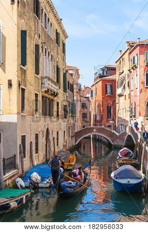 Ourists In Gondolas On Canal In Venice City