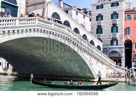 Traghetto Boat With Tourists Near Rialto Bridge