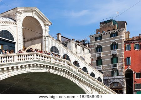 Tourists On Rialto Bridge Over Grand Canal
