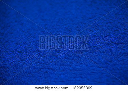 Dark blue fabric texture. Dark blue cloth background. Close up view of dark blue fabric texture and background. Abstract background and texture for designers. Navy blue texture.