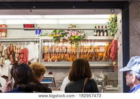 People In Butcher Shop In Padua