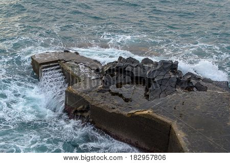 Stairs for swimming in the sea, dock with stairs, Madeira Island, Funchal.