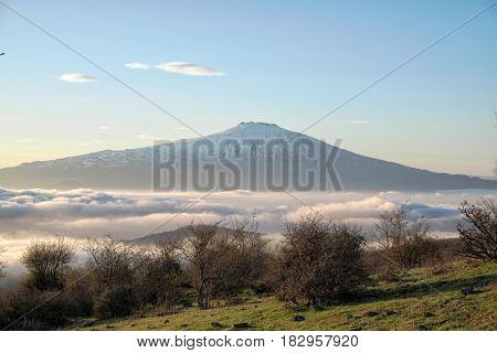 Volcano Etna over the low clouds from Nebrodi Park, Sicily