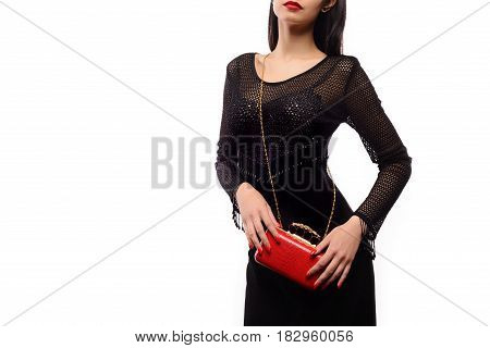 Fashionable Beauty Woman With A Red Bag And Black Evening Dress
