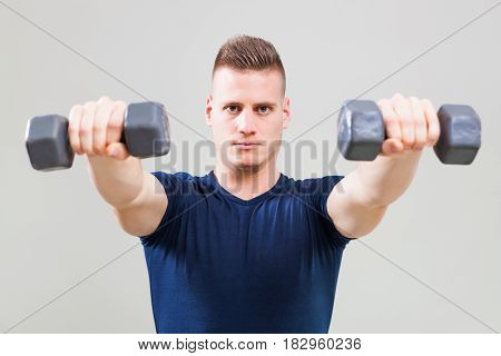 Studio shot image of young man who is exercising with weights.
