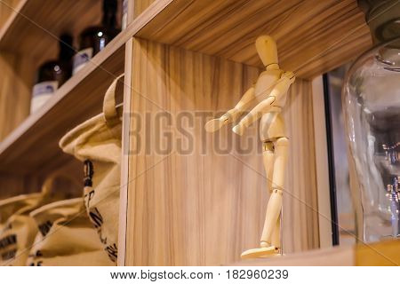 Wooden dummy on shelve with soft light.