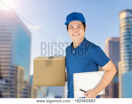 asian delivery man holding carton box and notepad