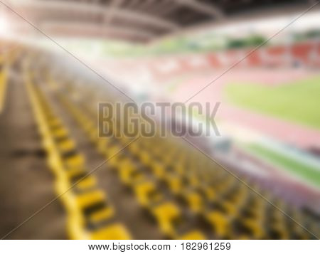sport stadium with yellow seats blurred background