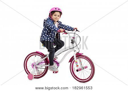 Little girl posing with a bicycle isolated on white background