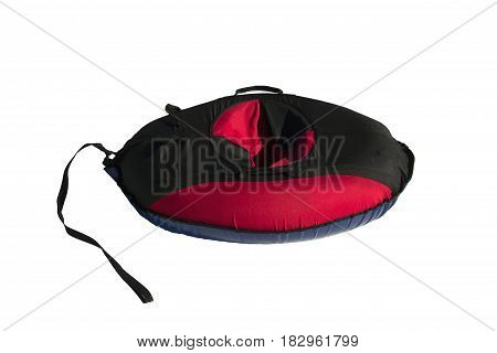 red and black material snow inner tubing (toobing) isolated on white background