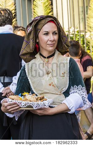 SELARGIUS, ITALY - SEPTEMBER 14, 2014: Ancient celibacy selargino - portrait of a beautiful woman dressing in traditional Sardinian costume - Sardinia