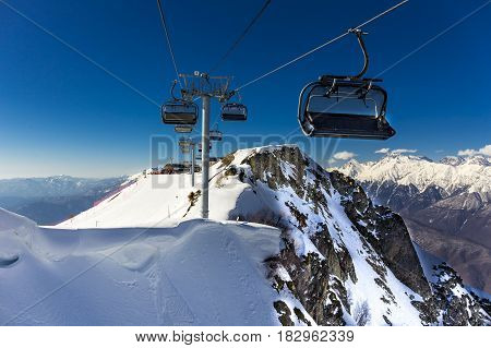Scenery top view on winter mountains with  ski elevators from ski resort Gorky Gorod